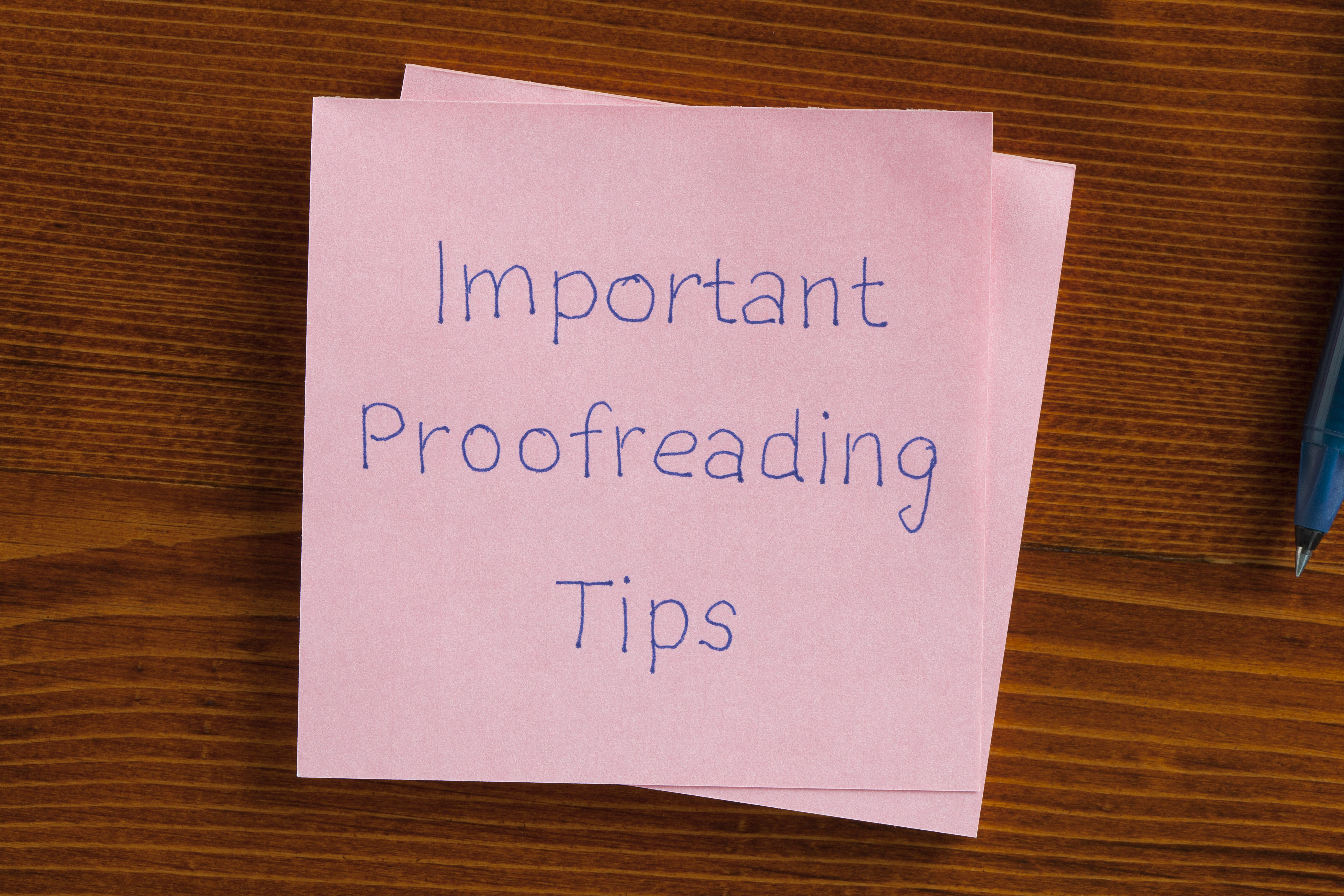 Image of a sticky note with the words Important Proofreading Tips